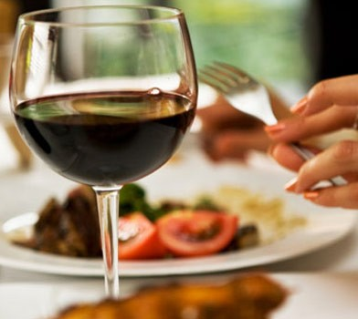 person eating dinner with red wine