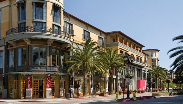 row of stores and palm trees