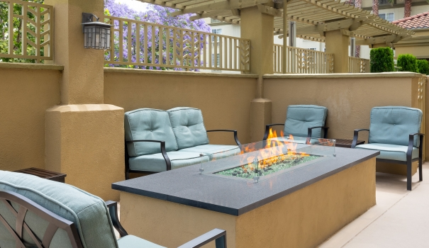 Outdoor seating with a large fire at Larkspur Landing