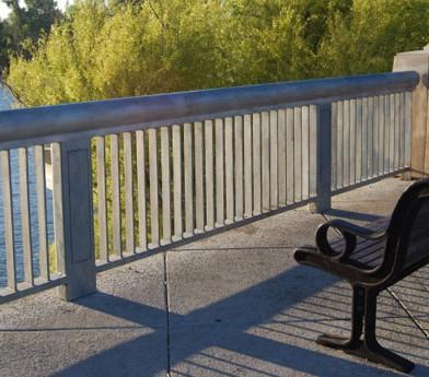park bench on bridge over river
