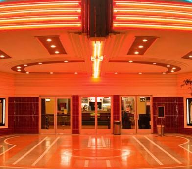 neon lit theater exterior