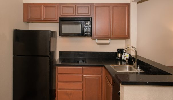 Microwave, refrigerator and stovetop in a Larkspur Landing studio suite