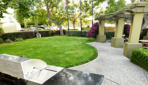 outdoor courtyard with barbeque and picnic tables