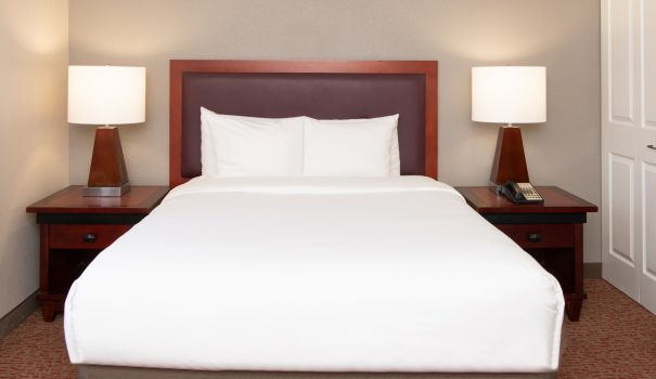 A freshly made bed in a Larkspur Landing hotel